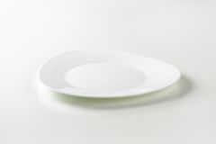 Trendy triangle white plate Royalty Free Stock Photography