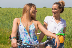 Trendy twin girls making a bike tour. summerfeeling. color edit Royalty Free Stock Photo