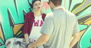 Trendy urban girl chatting with her boyfriend stock footage