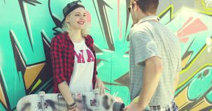 Trendy urban girl chatting with her boyfriend stock video footage