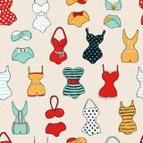Trendy vector seamless pattern with cute swimsuits Vector Illustration