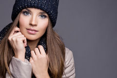 Trendy warm winter - beautiful young blonde woman in gray wool w. Inter hat and scarf smiling royalty free stock photo