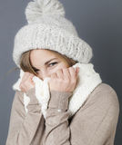 Trendy warm winter for cheeky young blond girl Stock Photo