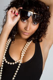 Trendy Woman. Trendy fashion woman wearing pearls Stock Photography