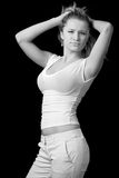 Trendy woman. Trendy beautiful girl in t-shirt and pants over black Stock Photo
