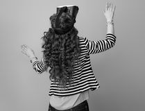 Trendy woman on background using VR headset Stock Photo