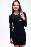 Trendy woman in black dress holding glass with champagne Stock Photos