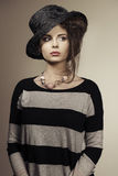 Trendy woman with black hat Stock Photos