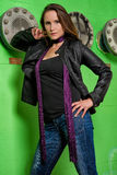 Trendy Woman in blue jeans posing in the grungy underground royalty free stock photography