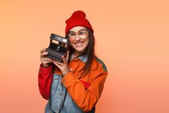 Trendy woman with camera Stock Images