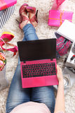 Trendy woman chilling with a laptop Royalty Free Stock Photo