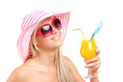 Trendy woman drinking an exotic cocktail Stock Photo