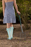 Trendy woman gardener in blue gumboots Royalty Free Stock Photography