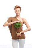Trendy woman holding potted plant Royalty Free Stock Photos