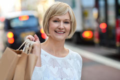 Trendy woman holding shopping bags Royalty Free Stock Images