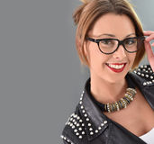 Trendy woman in leather clothes and eyeglasses Royalty Free Stock Photography
