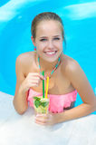 Trendy woman with lemonade in the pool Royalty Free Stock Photos