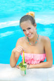Trendy woman with lemonade in the pool Royalty Free Stock Photo