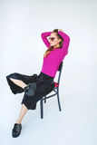 Trendy woman model with chair in pink on isolated background Stock Images