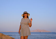 Trendy woman posing in evening light Stock Images