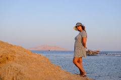 Trendy woman posing in evening light Royalty Free Stock Image