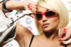 Trendy woman with  red sunglasses holding Stock Photography