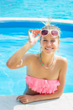 Trendy woman relaxing in the pool Royalty Free Stock Images