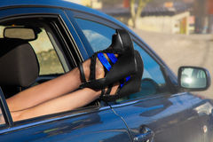 Trendy woman's shoes in window of car Stock Photo