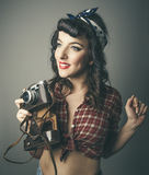 Trendy woman in 60s top with retro camera Stock Photo