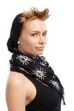 Trendy woman smiling in cap and scarf Stock Image