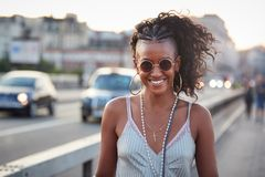 Trendy woman in striped camisole and sunglasses, portrait stock image