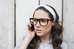 Trendy woman with stylish glasses having phone call Royalty Free Stock Photography