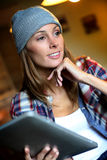 Trendy woman using tablet at home Stock Photo