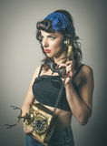 Trendy woman in vintage clothes with telephone Stock Photos