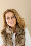 Trendy woman in winter clothes wearing eyeglasses Royalty Free Stock Image