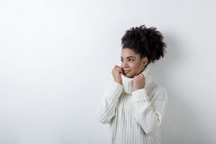 Trendy woman in winter clothes. By white wall Stock Images