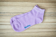 Trendy wool socks with inscription MONDAY Stock Photos