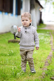 Trendy 2 years old baby boy posing. In spring/autumn park royalty free stock photos