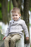 Trendy 2 years old baby boy posing. In spring/autumn park stock image