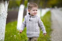 Trendy 2 years old baby boy posing. In spring/autumn park stock photography