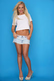 Trendy young blond woman in denim shorts Stock Photo