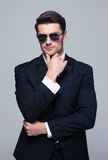 Trendy young businessman in sunglasses Royalty Free Stock Photography
