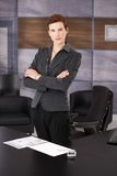 Trendy young businesswoman at work Royalty Free Stock Images
