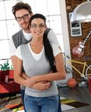Trendy young couple cuddling at home Stock Images