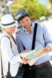 Trendy young couple sightseeing town Stock Photos
