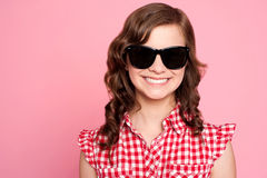 Trendy young girl in black goggles Stock Image