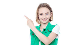 Trendy young girl pointing away Stock Images