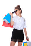 Trendy young girl with a shopping bag Stock Photo