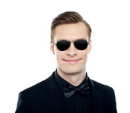 Trendy young male model wearing goggles Stock Images