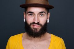 Trendy young man with beard and piercings Royalty Free Stock Photo